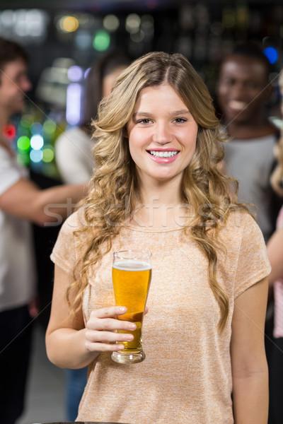 Smiling friends having beers Stock photo © wavebreak_media