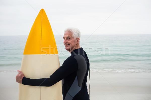 Feliz altos hombre tabla de surf playa Foto stock © wavebreak_media
