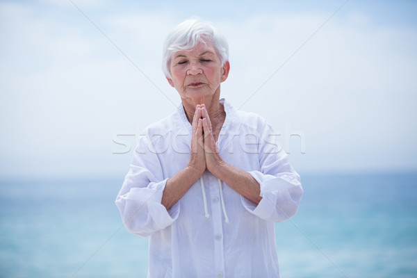 Senior woman with hands clasped Stock photo © wavebreak_media