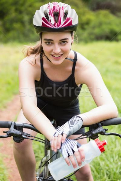 Kobieta posiedzenia rowerów szczęśliwy charakter Zdjęcia stock © wavebreak_media