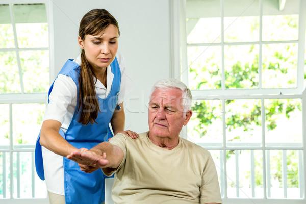 Senior man being examined by nurse Stock photo © wavebreak_media