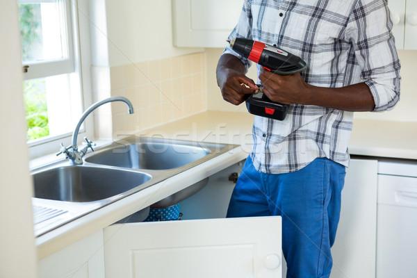 Man home keuken zwarte Stockfoto © wavebreak_media