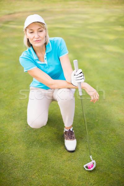 Golfer woman crouching on golf course Stock photo © wavebreak_media