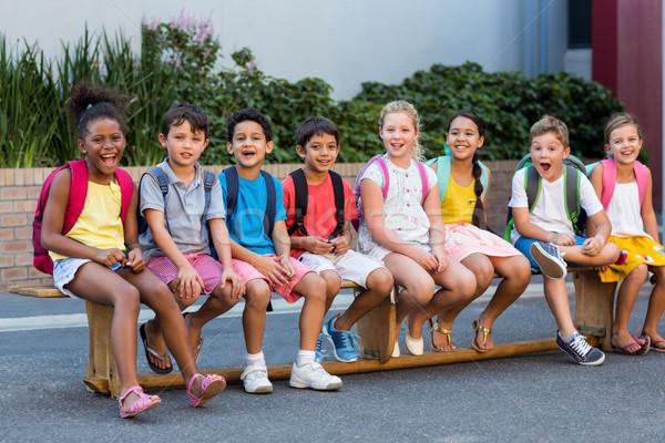 Lächelnd Schulkinder Sitz Porträt außerhalb Schule Stock foto © wavebreak_media