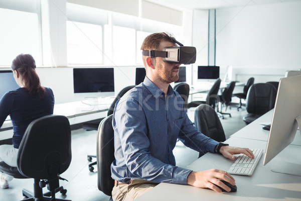 Mature student in virtual reality headset using computer Stock photo © wavebreak_media