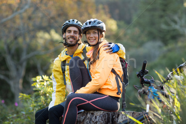 Biker couple sitting on a tree stump Stock photo © wavebreak_media