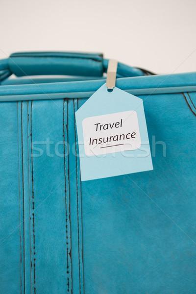 Voyage assurance étiquette valise bureau Photo stock © wavebreak_media