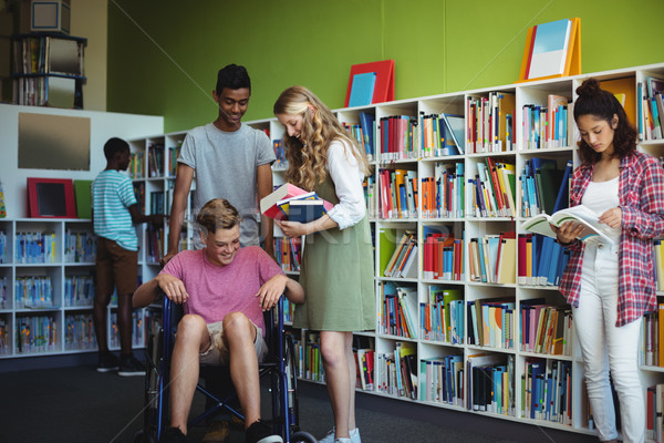 Students interacting with each other in library Stock photo © wavebreak_media