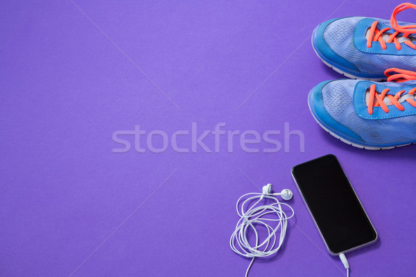 Sneakers, mobile phone with headphones Stock photo © wavebreak_media