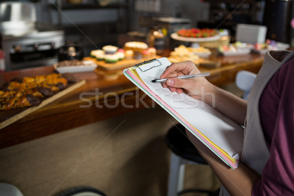 Mid-section of staff maintaining records on clipboard Stock photo © wavebreak_media