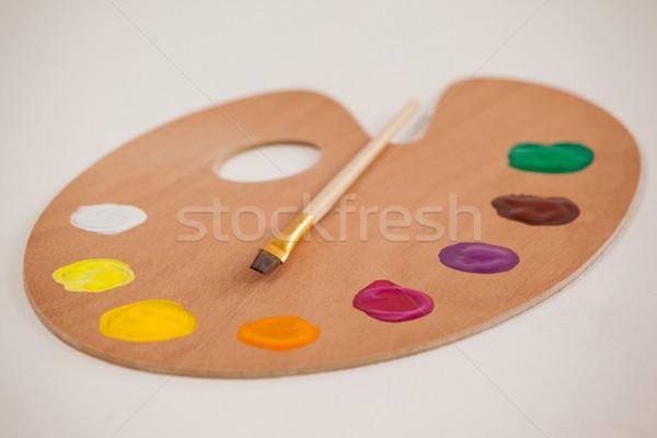 Paleta múltiple colores pincel educación mesa Foto stock © wavebreak_media