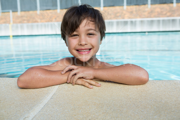 Portrait of young boy relaxing at poolside Stock photo © wavebreak_media