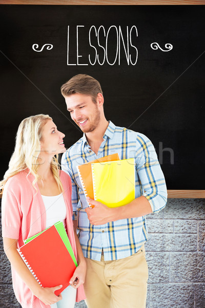 Lessons against chalkboard in classroom Stock photo © wavebreak_media