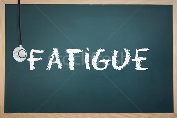 Fatigue against chalkboard Stock photo © wavebreak_media