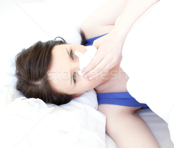 Sick attractive woman relaxing in her bed Stock photo © wavebreak_media