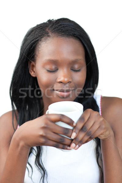 Delighted woman drinking a coffee Stock photo © wavebreak_media