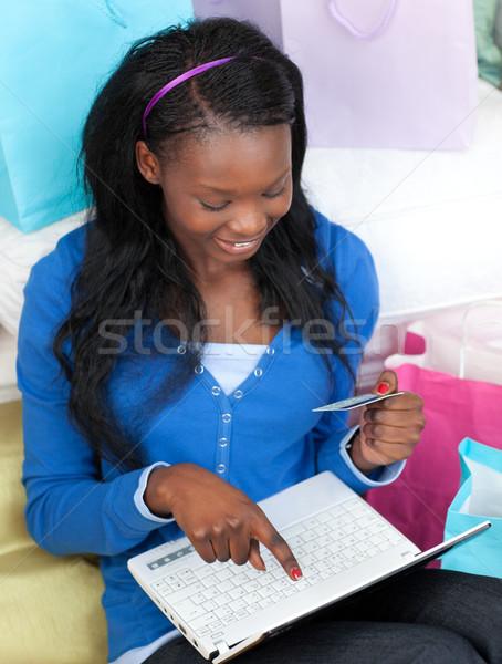 Smiling teen girl shopping on-line Stock photo © wavebreak_media