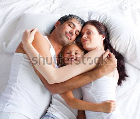 Hermano hermana jugando padres cama feliz Foto stock © wavebreak_media