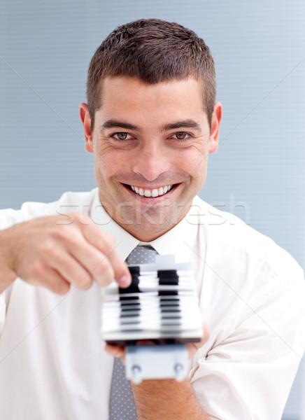Attractive businessman consulting a directory Stock photo © wavebreak_media