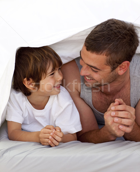 Father and son talking under the bedsheets Stock photo © wavebreak_media
