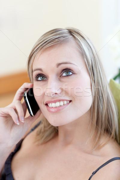 Mulher atraente falante telefone sessão sofá casa Foto stock © wavebreak_media