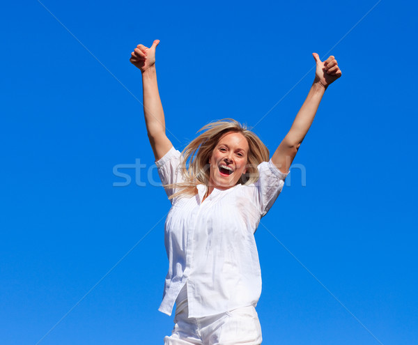 Lively woman jumping in the air Stock photo © wavebreak_media