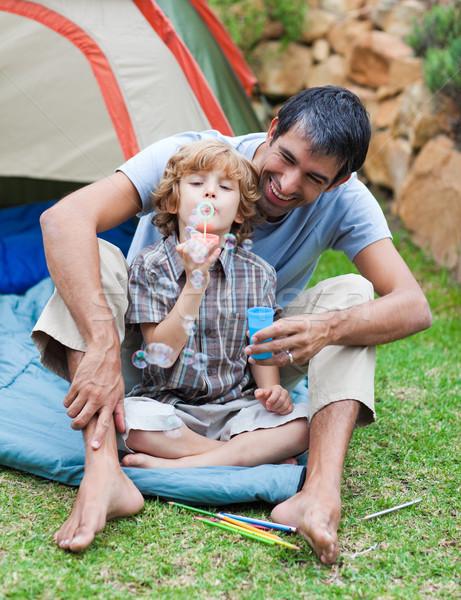 Apa fia buborékfújás sátor boldog gyermek tájkép Stock fotó © wavebreak_media