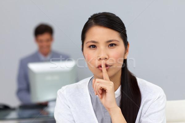 Serious businesswoman asking for silence Stock photo © wavebreak_media