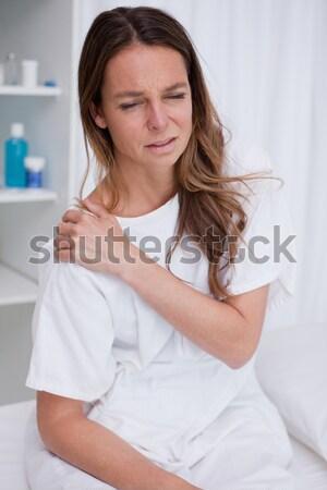 Adorable girl on a bed against white background Stock photo © wavebreak_media