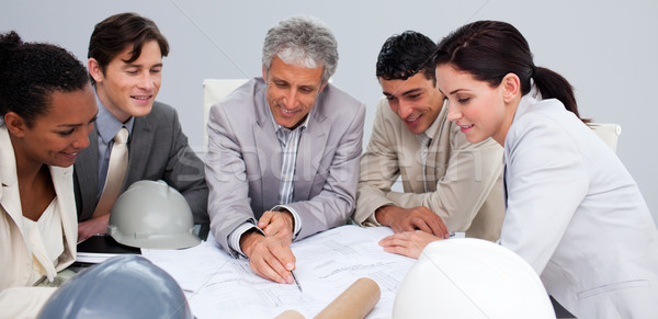 Constructors in a meeting studying plans Stock photo © wavebreak_media
