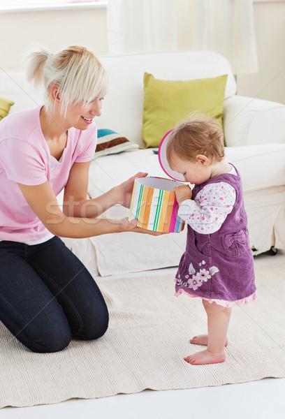Young mother get surprise by her daughter in living room Stock photo © wavebreak_media