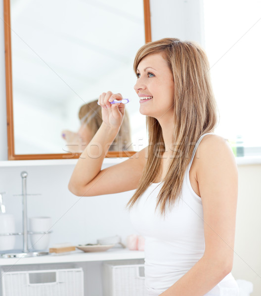 Blond young woman brush her teeth in the bathroom Stock photo © wavebreak_media