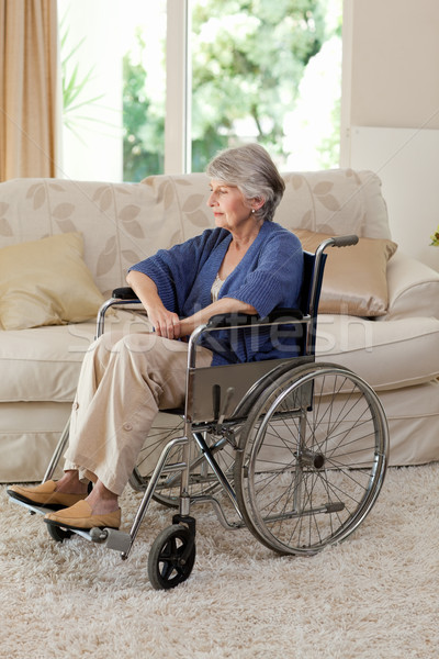 Retired woman in her wheelchair at home Stock photo © wavebreak_media