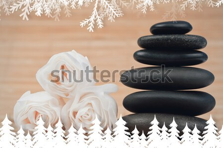 Roses and a black pebbles stack against a bamboo background Stock photo © wavebreak_media