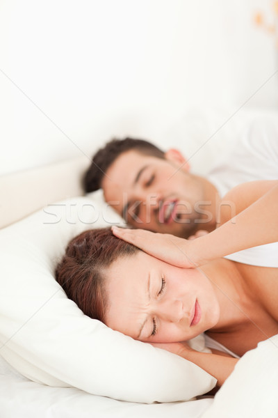 Woman not able to sleep because of snoring in the bedroom Stock photo © wavebreak_media