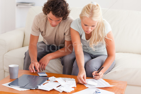 Couple working together in the living room Stock photo © wavebreak_media