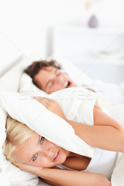 Portrait of an unhappy woman awaken by her fiance's snoring in their bedroom Stock photo © wavebreak_media