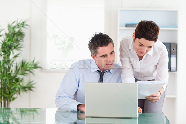 Colleagues comparing a blueprint document to an electronic one in an office Stock photo © wavebreak_media