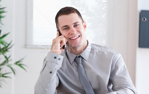 Sorridente empresário agradável notícia telefone móvel negócio Foto stock © wavebreak_media