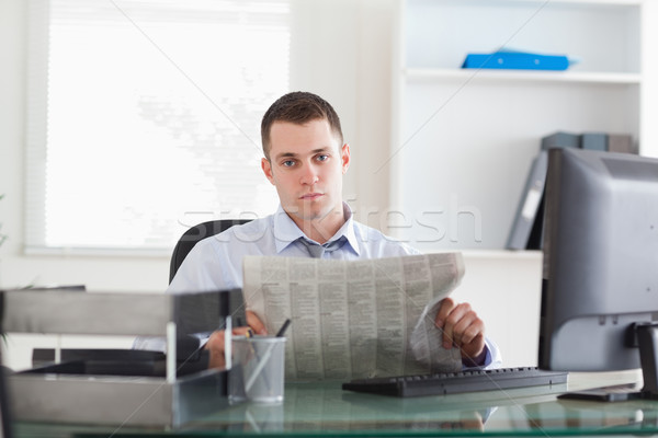 Young businessman reading the news Stock photo © wavebreak_media