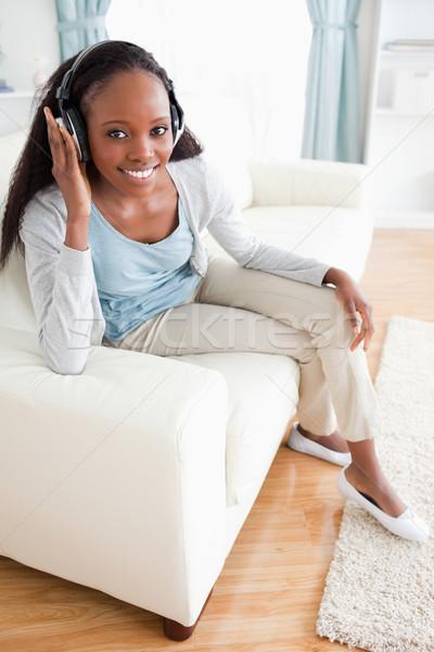 Gülümseyen kadın oturma kanepe kulaklık müzik ses Stok fotoğraf © wavebreak_media