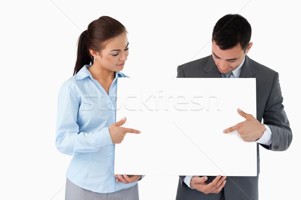 Бизнес-партнеры указывая знак белый рук Сток-фото © wavebreak_media
