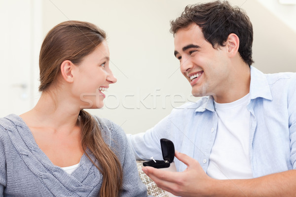 Delighted man proposing marriage to his girlfriend in their living room Stock photo © wavebreak_media