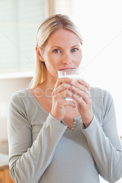 Young woman drinking some water Stock photo © wavebreak_media