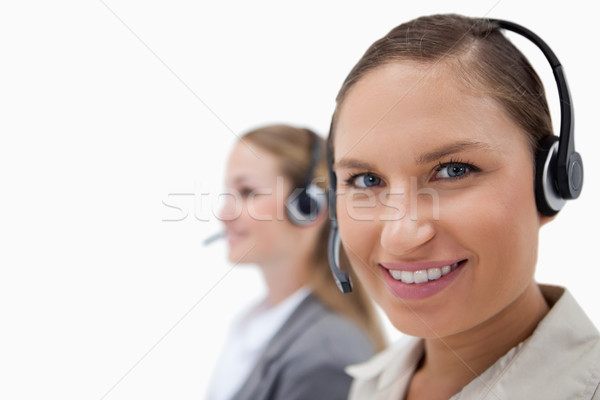 Sales persons using headsets against a white background Stock photo © wavebreak_media