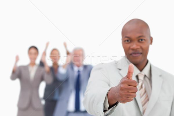 Verkoper team achter goedkeuring witte hand Stockfoto © wavebreak_media