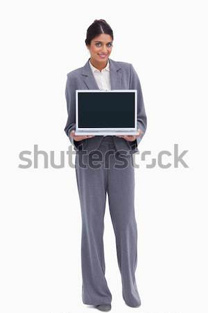 Saleswoman showing the screen of her laptop against a white background Stock photo © wavebreak_media