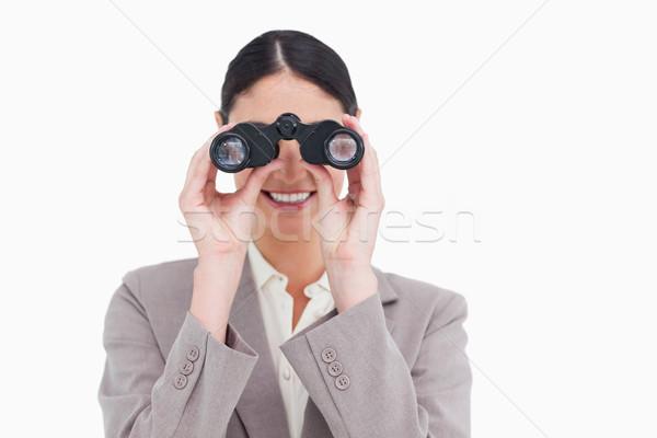 Souriant femme d'affaires regarder espion verres blanche Photo stock © wavebreak_media