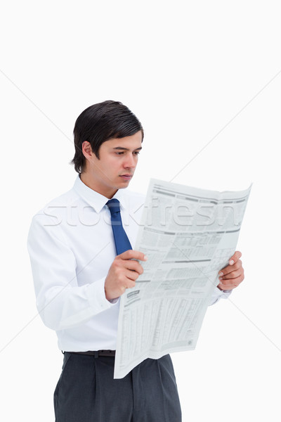Young tradesman reading the news against a white background Stock photo © wavebreak_media