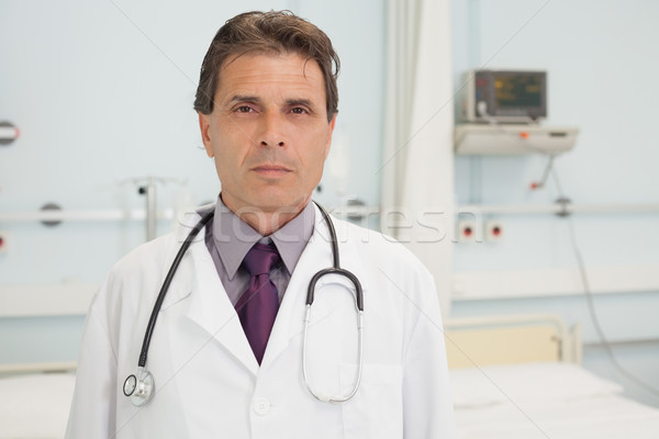 Stock photo: Serious doctor standing in hospital bedroom